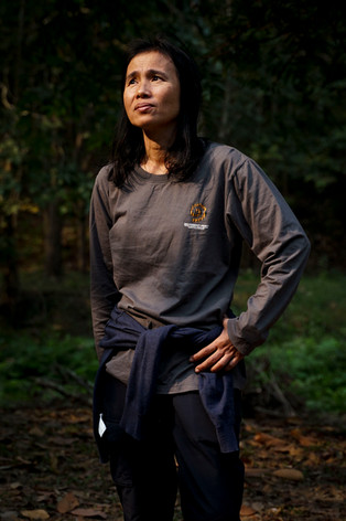 Dr. Achara Simcharoen poses for a portrait near the Khao Nang Rum Wildlife Research Station on Jan. 14, 2020. The mother of three, Simcharoen acts as the head tiger biologist working out of Khao Nang Rum and along with her husband,  Dr. Saksit Simcharoen. The two have helped ensure Huai Kha Khaeng remains one the healthiest sites for tiger populations in Southeast Asia.