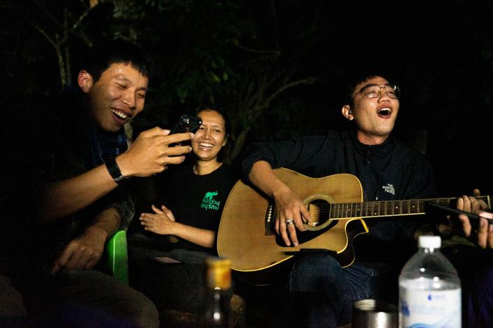 From left, Phornchai Ruangsuwan, Raksuda Poobaibua and Chanon Chirajitmichai sing songs on New Year's eve at Kao Nang Rum, the primary research station in Huai Kha Khaeng.