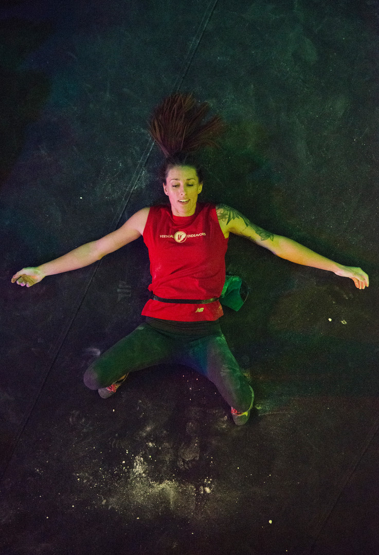 Alex Johnson lays on the ground after falling on an attempt of the final problem of Boulderfest North, a climbing competition hosted by the Minneapolis Bouldering Project, on Saturday, Nov. 10.