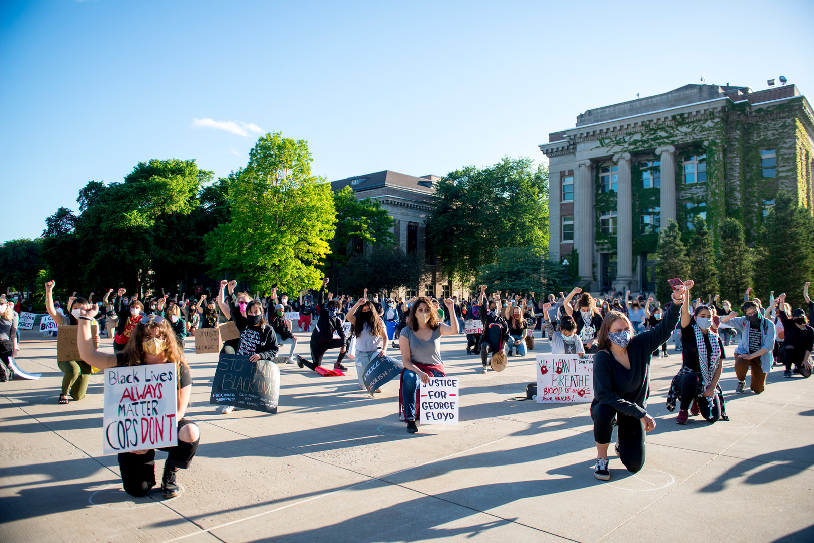 Student demonstrators gather outside of Northrup Auditorium on Friday, May 29 to protest the killing of George Floyd and the Minneapolis Police Department. Chalk marks were drawn 6-feet apart to help the crowd with social distancing.