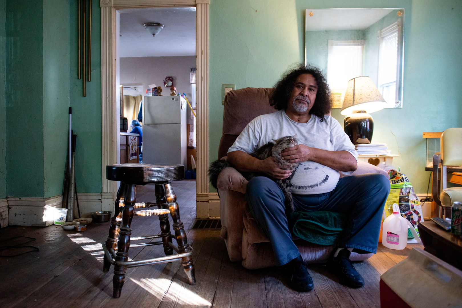 Wesely Pettiford poses for a portrait in his home in St. Paul on Saturday, Oct. 26, 2019. Pettiford, who is being evicted from the home, requires dialysis treatment three times a week and faces a speech disability. The case highlights a decades-old policy where homes such as Pettiford's are targeted and put on an accelerated foreclosure schedule.