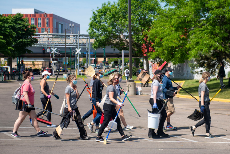 Volunteers gather to clean the area surrounding the 3rd Precinct in Minneapolis on Sunday, May 31.