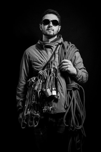 Ben Wax poses for a portrait with his late uncle's rock climbing equipment on March 30, 2019. Wax sees climbing as a way to connect with his uncle despite not getting the chance to know him while he was alive.