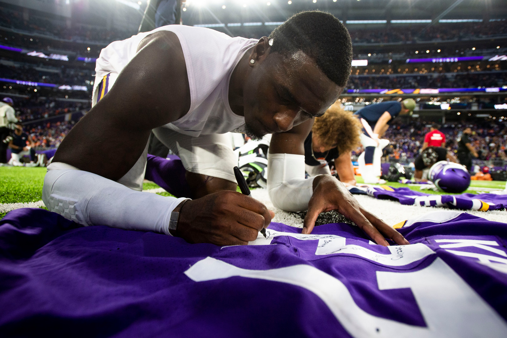 Minnesota Vikings safety Jayron Kearse (27) signs his jersey after defeating the Broncos at U.S. Bank Stadium on Sunday, Nov. 17, 2019. The Vikings won with a final score of 27-23.