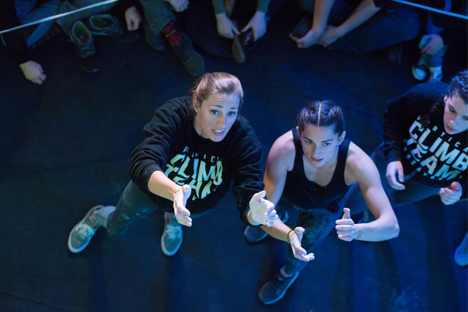 Professional climbers Alex Johnson and Kyra Condie examine a problem before competing in the finals of Boulderfest North, a climbing competition hosted by the Minneapolis Bouldering Project, on Saturday, Nov. 10.