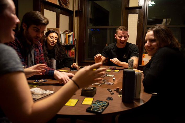 """Diamond plays a final """"game night"""" with friends he made while enrolled as an acting major. While his educational goals shifted over the course of a 5 and a half year undergraduate career, the community he found in his early acting days helped support his emerging identity."""