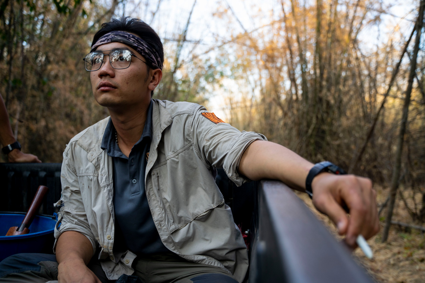 Chanon Chirajitmichai rides in the bed of a work truck back to the Kao Nang Rum Research Station after day in the field.