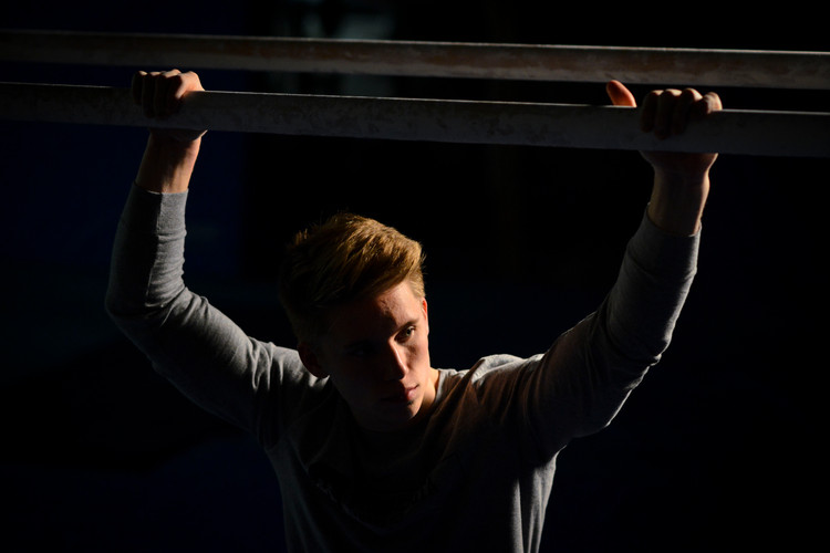 Sophomore Shane Wiskus poses for a portrait in Cooke Hall on Friday, April 30, 2019. Wiskus was named as the Big Ten Gymnast of the Year for the second consecutive season and was the 2019 NCAA Men's Parallel Bars champion.