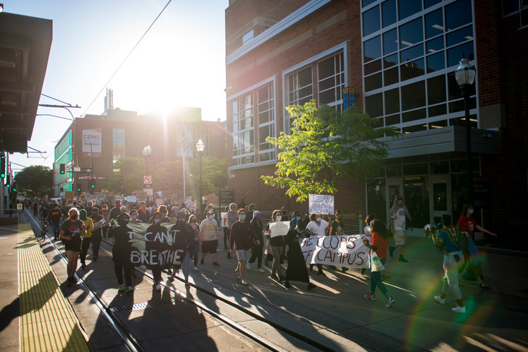 Student demonstrators march outside of the University of Minnesota Police Department Headquarters on Friday, May 29 to protest the killing of George Floyd and the Minneapolis Police Department.