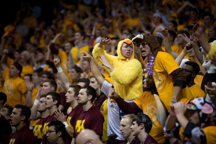 "Fans cheer on the Gophers inside Williams Arena, otherwise known as ""The Barn."""