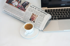 image of newspaper and laptop