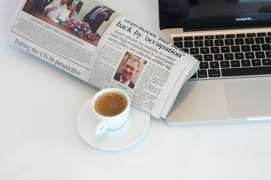 laptop, espresso, newspaper