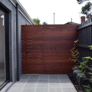 Merbau side gate and screen in Bluestone paved area