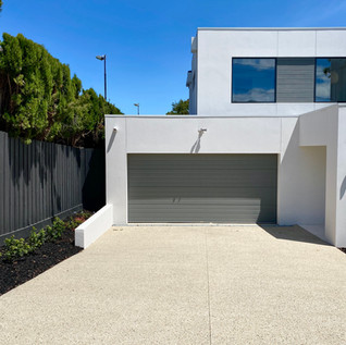 White Exposed Aggregate concrete driveway