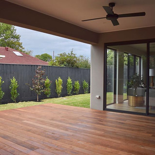 Large Merbau decking alfresco area with feature tree garden beds