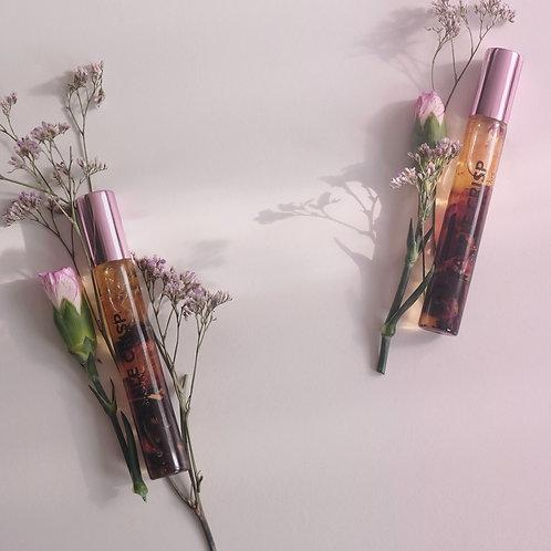 huile pour lèvres apple crisp infusée aux cristaux et aux fleurs