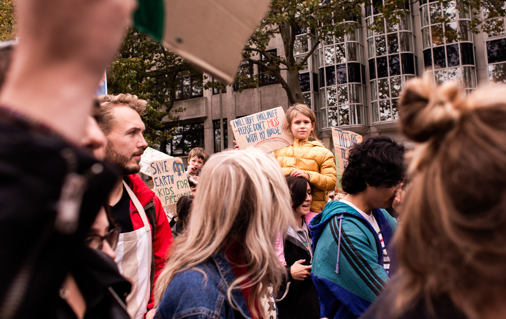 A little girl on the shoulders of her mother at the first general climate strike in Den Haag, The Netherlands, on September 27, 2019. Building on the youth climate strikes that began almost a year ago, an estimated 35,000 people of all ages gathered to demand change in Dutch and international climate policy. The strike was a part of the largest international climate mobilization in history.