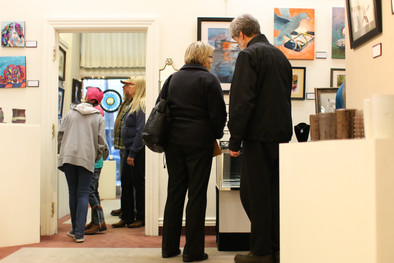 People gather in an art gallery as part of Logan City Limit's gallery walk on April 6, 2017. Logan City Limits is a music, art, and film festival hosted each year by Aggie Radio and the Utah State University Student Association. The festival is held in historic downtown Logan, allowing people to move about the numerous events hosted at various theaters, restaurants, and streets.