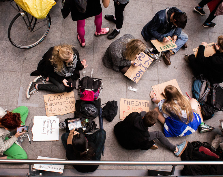 People make signs before the first general climate strike in Den Haag, The Netherlands, on September 27, 2019. Building on the youth climate strikes that began almost a year ago, an estimated 35,000 people of all ages gathered to demand change in Dutch and international climate policy. The strike was a part of the largest international climate mobilization in history.