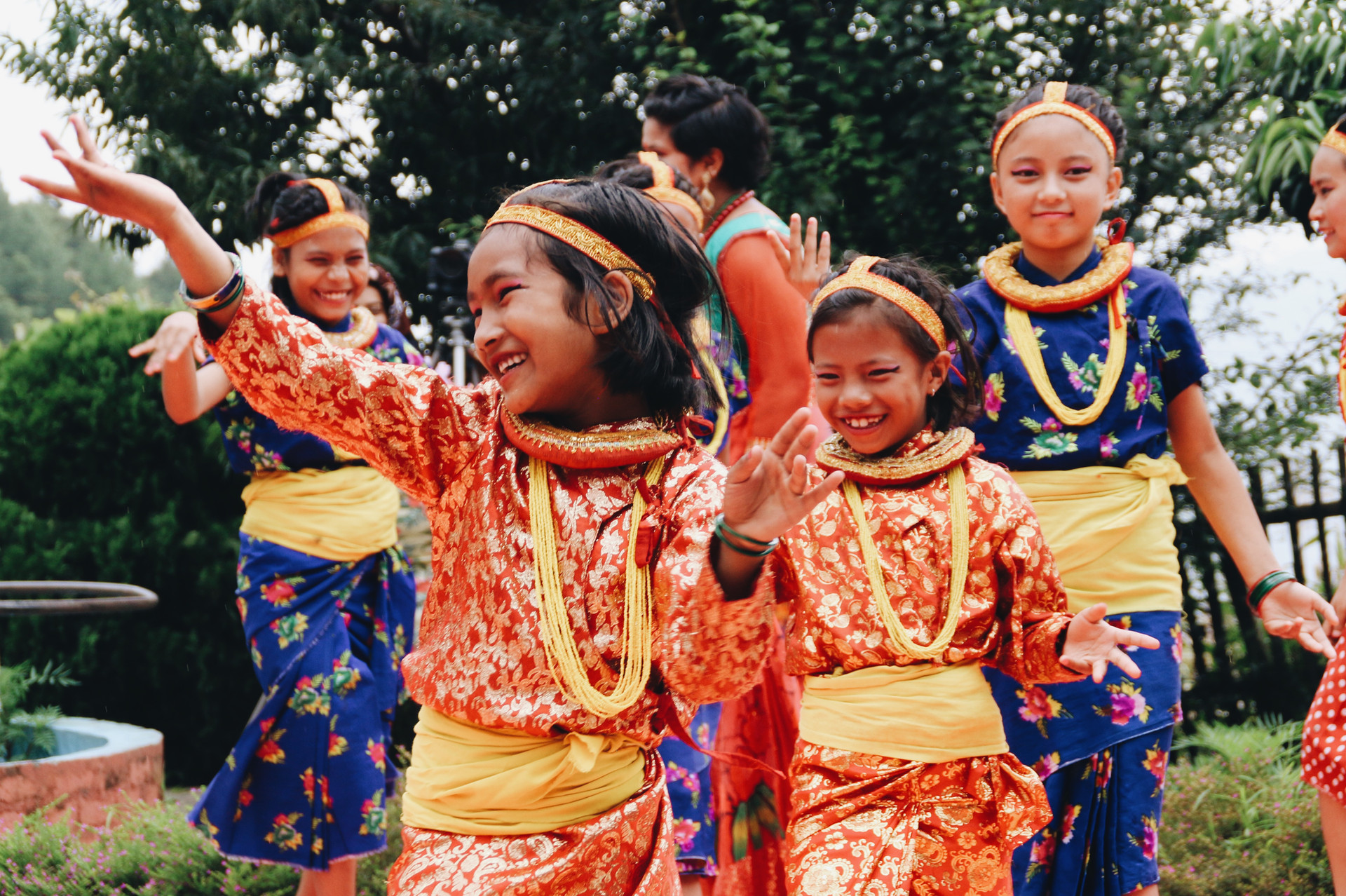 The girls at Raksha, a center in Nepal for young girls who have been sexually abused, dance in celebration of Teej in August, 2017. Teej is a holiday welcoming monsoon season and is mainly celebrated by women and girls. The girls at Raksha dressed up in their nicest outfits and celebrated the day with dance, song, and lots of food.