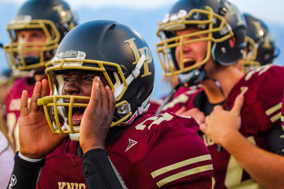 Lone Peak's Kwasi Foutz cheers on his team from the sidelines in the Lone Peak vs. Bountiful football game on August 21, 2015, in Highland, Utah. Lone Peak won the game, their season opener, 31-0.