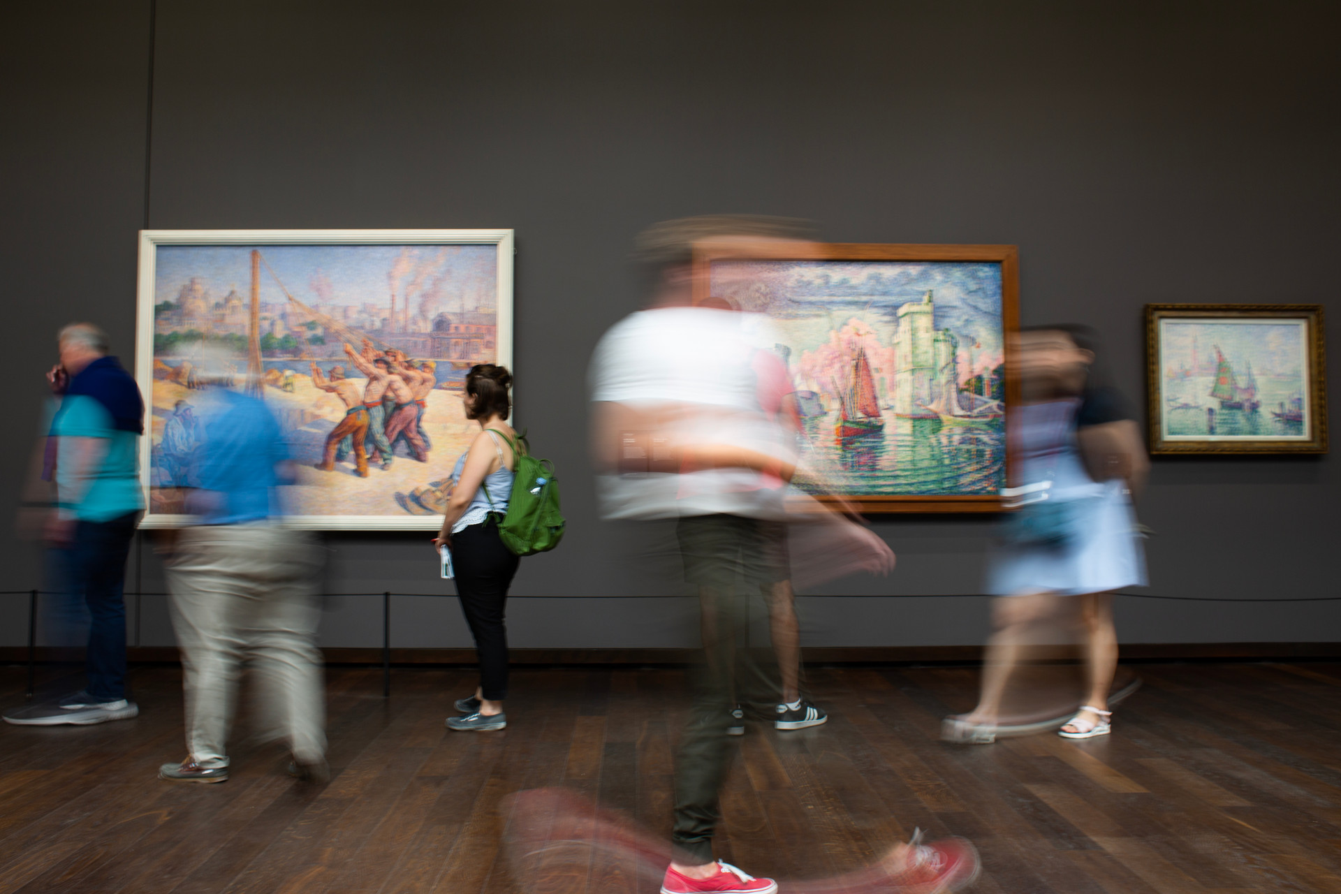 Visitors walk in the Impressionist gallery at the Musee D'Orsay in Paris, France.
