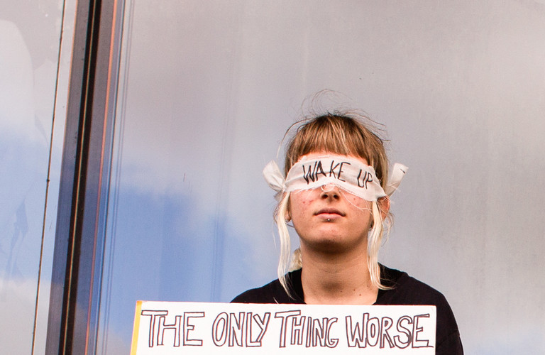 "A girl sits blindfolded with a sign that reads ""The only thing worse than being blind is having sight but no vision,"" at the first general climate strike in Den Haag, The Netherlands, on September 27, 2019. Building on the youth climate strikes that began almost a year ago, an estimated 35,000 people of all ages gathered to demand change in Dutch and international climate policy. The strike was a part of the largest international climate mobilization in history."
