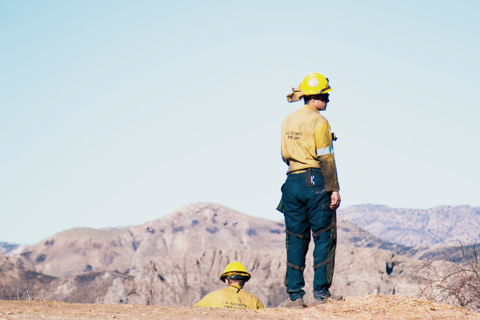 Firefighters stands in Kanan Canyon in Los Angeles county California on Jan. 3, 2019. Kanan Canyon was severely burnt in November 2018 and months later firefighters, construction workers, electricians and many more are still working to repair damages.