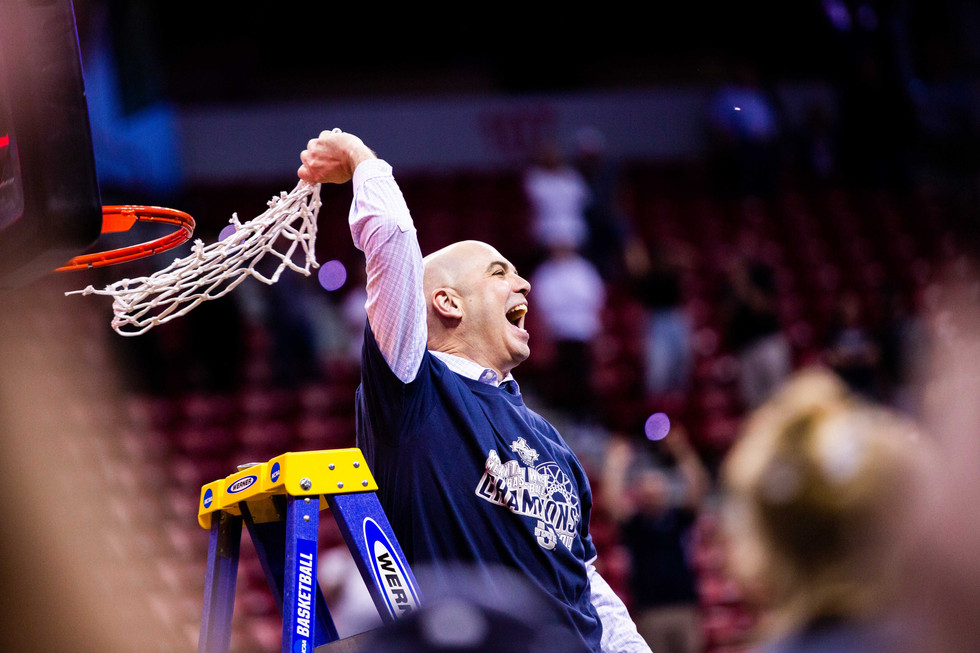 Utah State Aggies head coach Craig Smith celebrates the team's victory in the Mountain West title game against the San Diego State Bulldogs in the Thomas and Mack Center in Las Vegas, Nevada, on March 16, 2019. The Aggies won the game 64-57 and will take home the Mountain West title along with a bid for the NCAA Tournament.