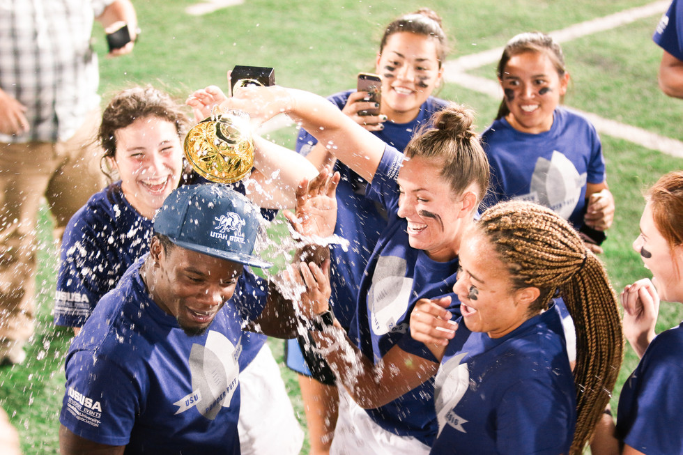 The winning powderpuff team celebrates, pouring water over the head of their coach, after the championship game on September 20, 2016.