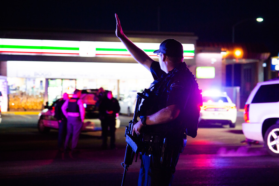 Logan City police officers and SWAT Team members at a standoff in the 7-11 parking lot at 400 North and Main Street in Logan, Utah, on Oct. 29, 2018.