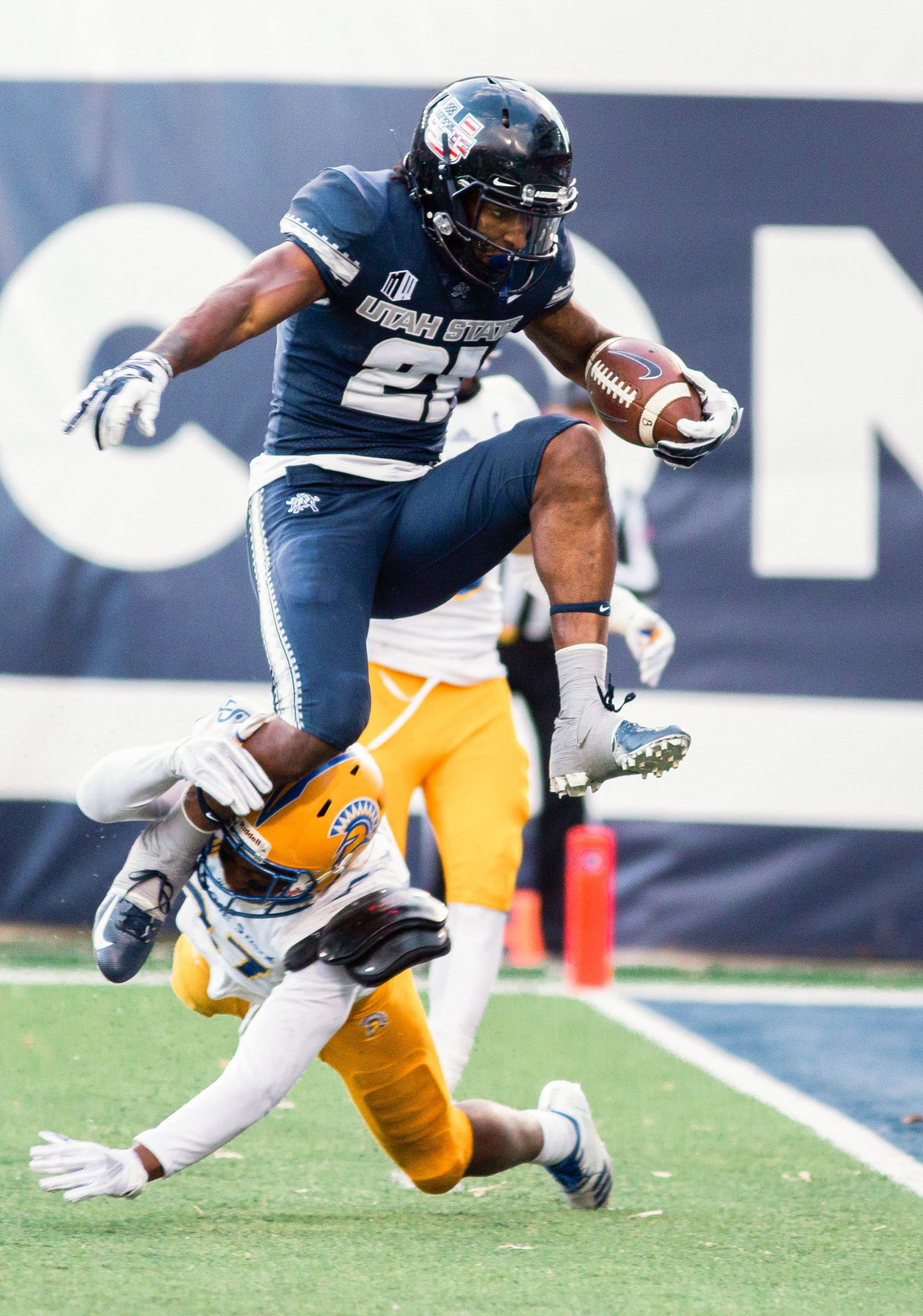 Utah State's Jalen Greene hurdles a San Jose player for a touchdown at the last home game of the season against San Jose State on Nov. 11, 2018 in Logan, Utah. Aggies went undefeated on their home turf with a 62-24 win against the Spartans.