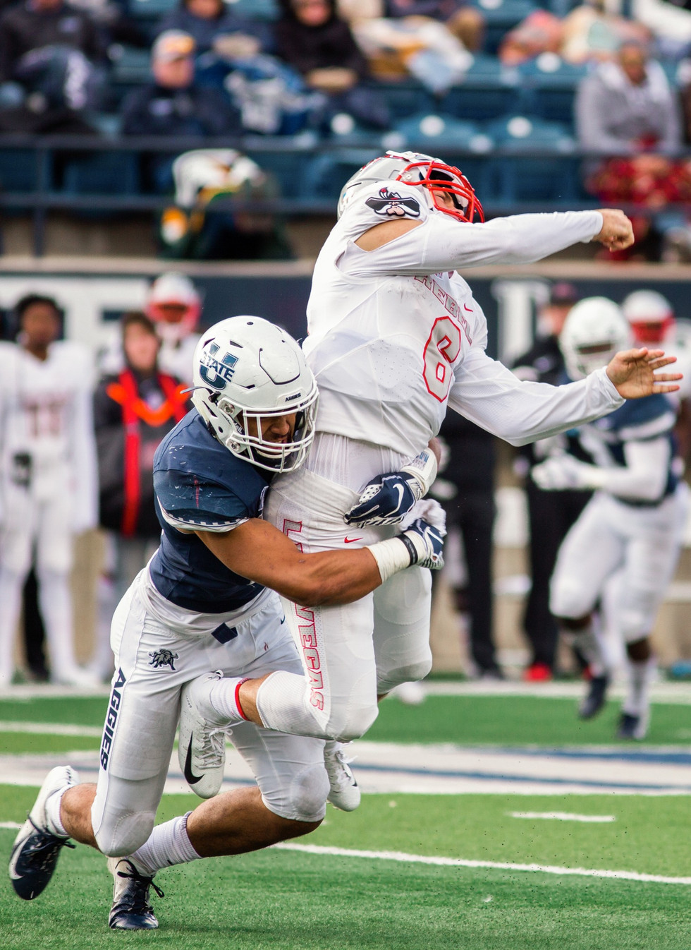 Utah State University linebacker David Woodward tackles University of Las Vegas Nevada quarterback Max Gilliam at the Maverik Stadium on October 13, 2018. Utah State University won the game 59-28 and Woodward recorded 8 solo tackles, a career-high for the sophomore linebacker.