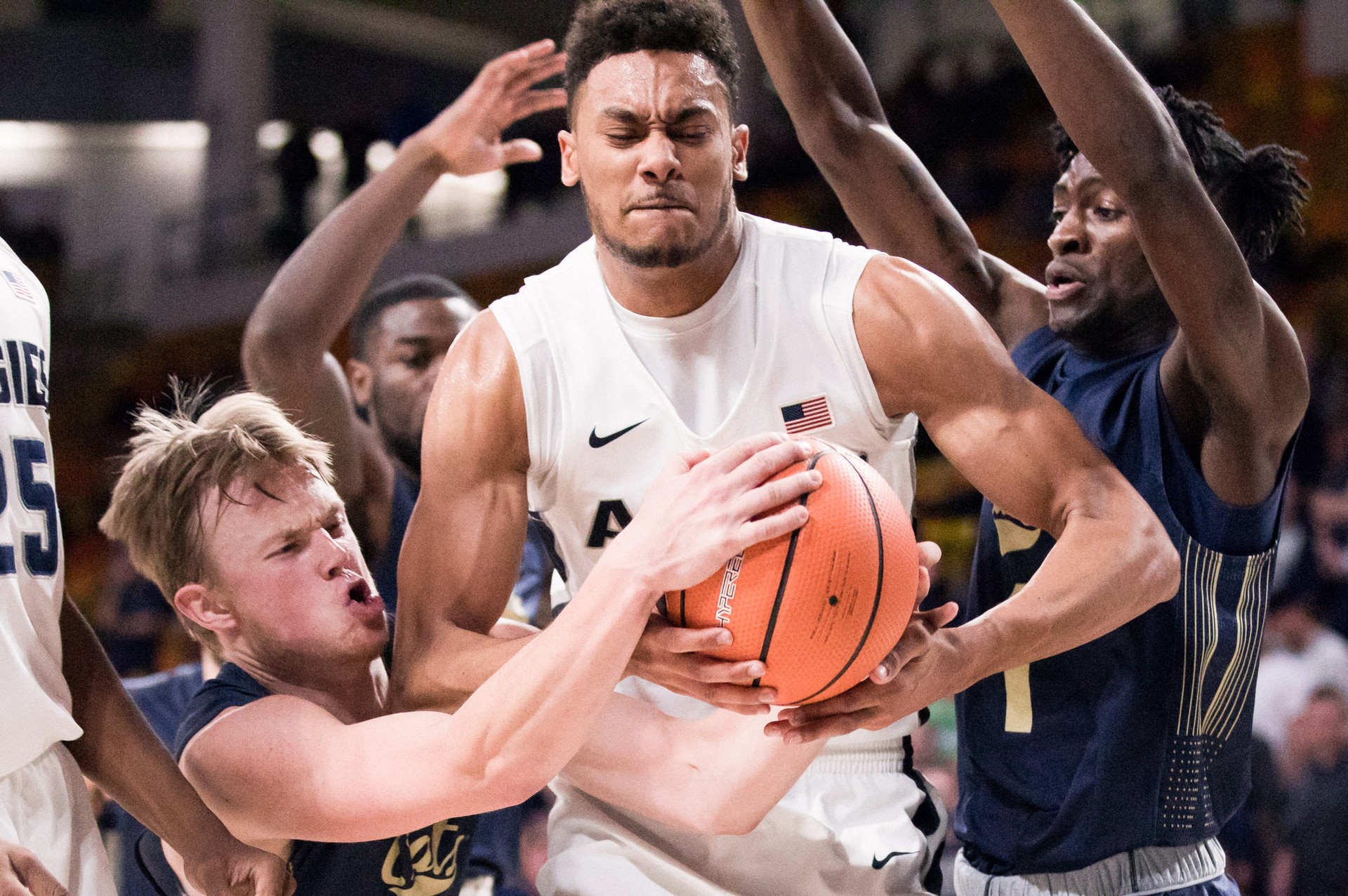 Utah State University's Alex Dargenton fights for control of the ball in the USU vs Montana State University basketball game at the Dee Glen Smith Spectrum in Logan, Utah, on Nov. 13, 2017.