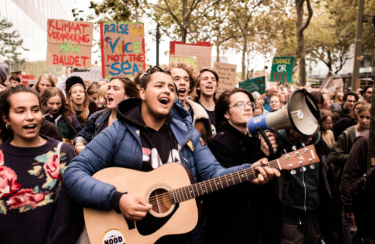 People chant and sing as they march down the streets at the first general climate strike in Den Haag, The Netherlands, on September 27, 2019. Building on the youth climate strikes that began almost a year ago, an estimated 35,000 people of all ages gathered to demand change in Dutch and international climate policy. The strike was a part of the largest international climate mobilization in history.