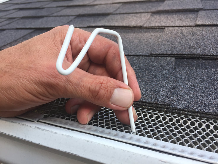 White Christmas Hook fits gutters with mesh leaf gutter guard, How to hang Christmas lights on gutter guard