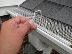 Christmas Hook fits gutters with mesh or perforated gutter guard