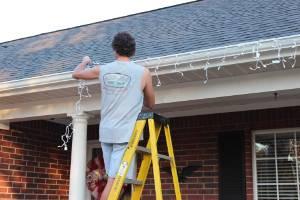 Hanging Christmas lights on gutter guard using Christmas Hook