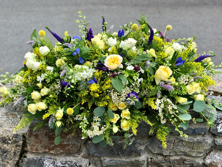 Garden Style Coffin Spray of Yellow, Blue, White & Green Flowers