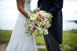 Bride and Groom with bouquet of flowers