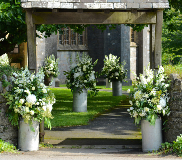 Vintage Milk Churns with White & Green Flowers and Foliage