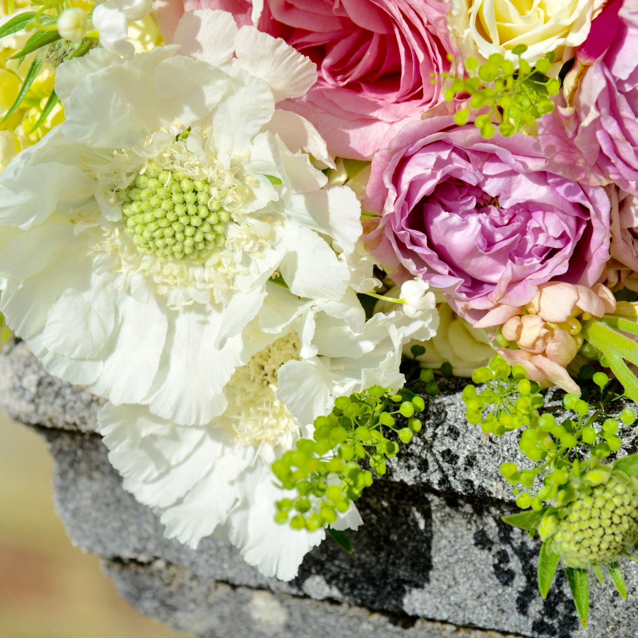 Deliciously scented bridal bouquet of pink, peach and ivory flowers, including Lily of the Valley, stocks, roses, freesias, scabious, thylaspi, oregano. Blue Geranium Florist Totnes Devon