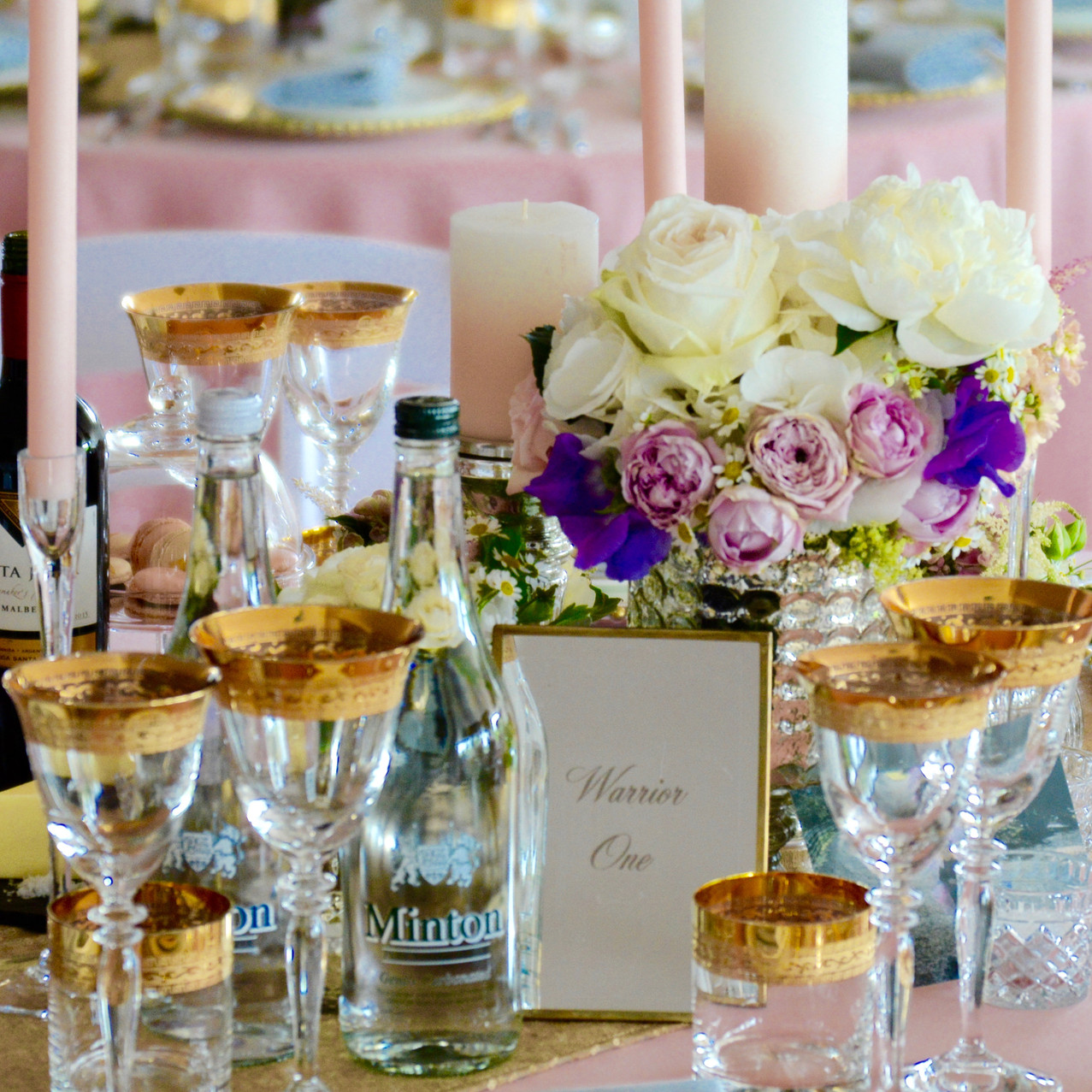 Eight of the 15 guest tables were decorated with low level vases, decorated with a mercury effect design and complete with coordinating flowers and foliage.