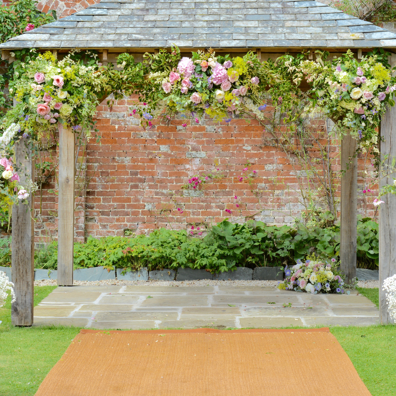 Wedding Ceremony Pergola at Kingston House, South Devon - Blue Geranium Florist Totnes Devon