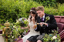bride and groom with champagne and flowers