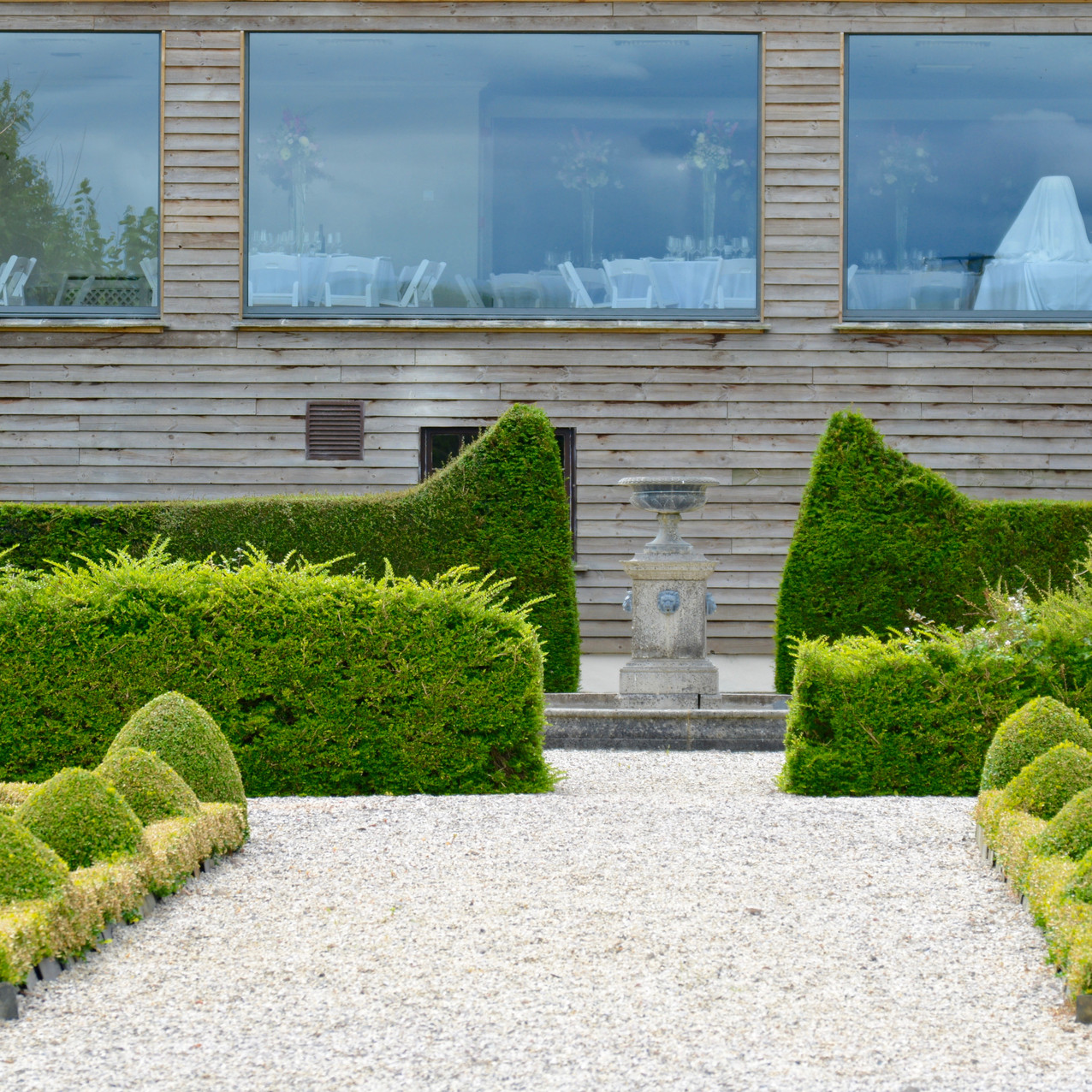 View from outside the Reception Barn at Kingston House - Panoramic window seen from the parterre