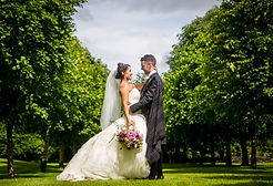 Bride and Groom with bouqet of flowers