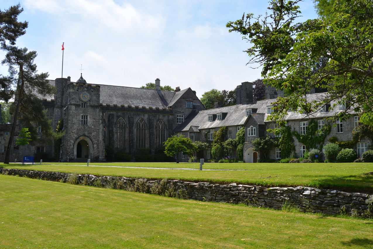 Image of the quadrangle at Dartington Hall, looking at The Great Hall from the Barn Cinema