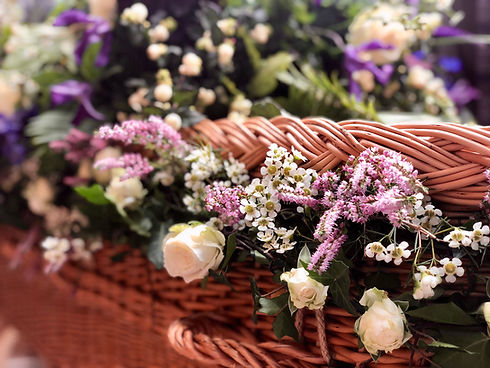 wicker coffin with floral garland