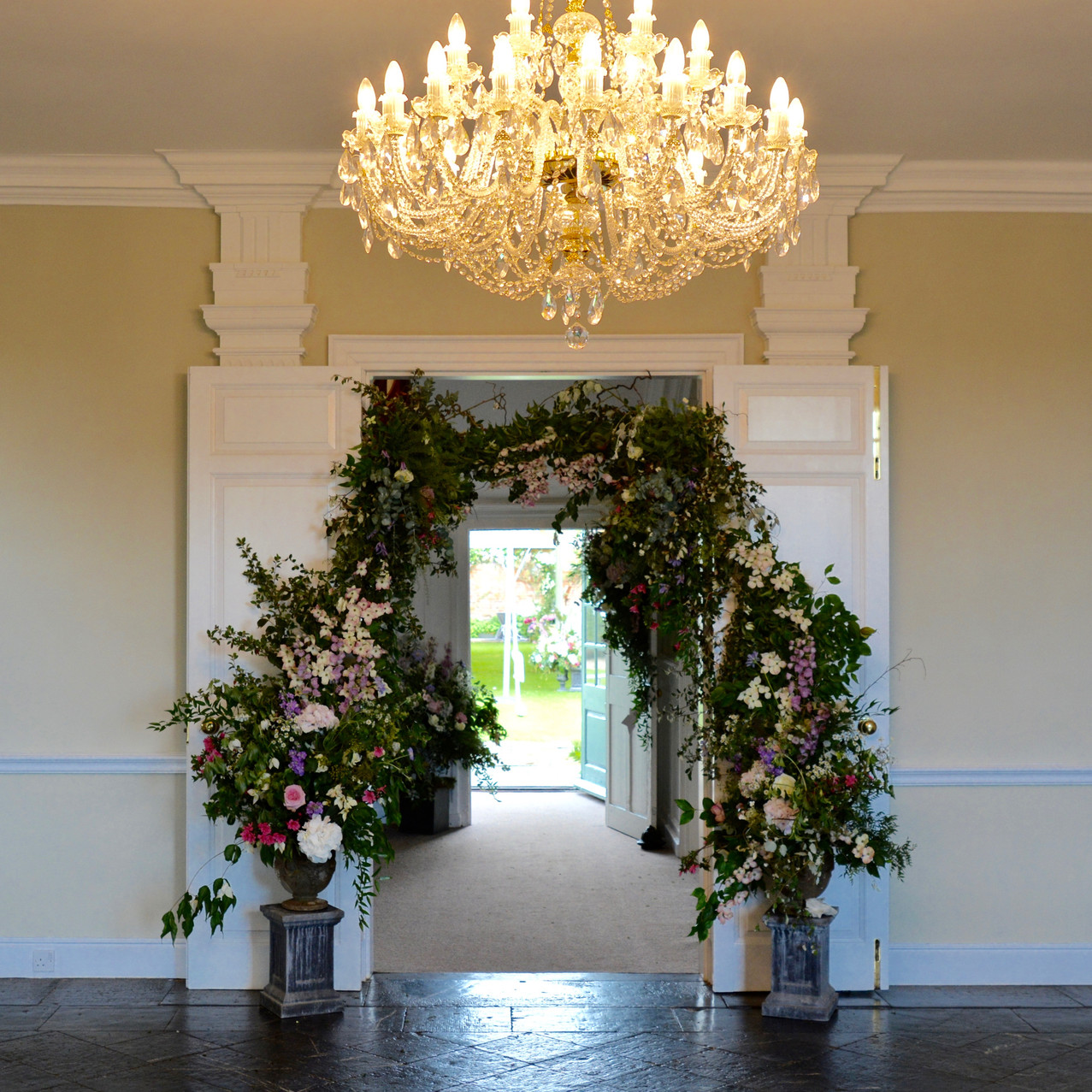 Entrance room of Kingston House - doors leading towards the grand staircase and ceremony garden. Doors